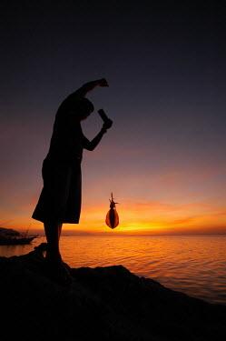 Fisherfolk using traditional fishing method.