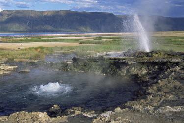 Erupting geyser and hot spring