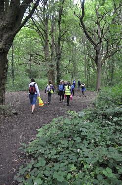 Children and volunteers in woodland at BioBlitz event near Bristol, UK Children,nature,BioBlitz,survey