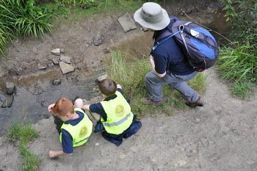 Children and volunteer taking part in BioBlitz survey Children,nature,BioBlitz,survey