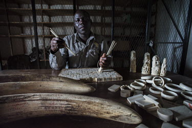 Ivory process, from tusk to chopsticks Africa,ivory,poaching,conservation threats,animal trade,illegal,conservation issue,death,crime,tusk,tusks,wildlife crime,wildlife trade,confiscated,animal products,statues,jewelery,Elephants,Elephanti