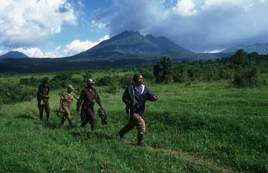 Park guards patrolling boundary of Virunga National Park people,Africa,armed,camouflage,Central Africa,conservation,day,ranger,firearm,firearms,guard,guards,gun,guns,male,man,patrol,patrolling,patrols,rifle,security staff,weapon,weaponry,weapons,poaching,po