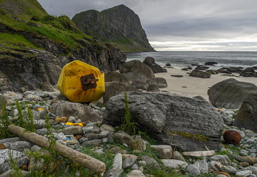 Plastic drum found on a remote stretch of coastline on Vry. norway,coast,july,nordland,marine debris,marine litter,moody,atmospheric,plastic drum,litter,beach rocks
