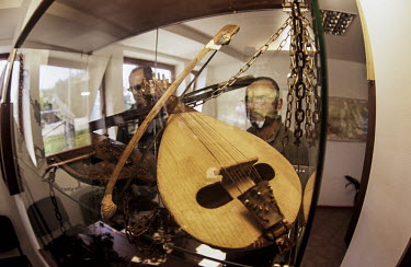 Musical instruments in showcase Conservation,protection,environmental issues,recovery centre,dancing bears,Carnivores,Carnivora,Bears,Ursidae,Chordates,Chordata,Mammalia,Mammals,Africa,Semi-desert,Europe,Broadleaved,North America,Tu