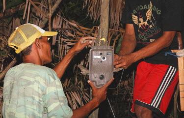 Setting up a camera trap on a Javan rhinoceros project camera trapping,camera trap,Ujung Kulon National Park,conservation,project,people,Rhinocerous,Rhinocerotidae,Chordates,Chordata,Mammalia,Mammals,Perissodactyla,Odd-toed Ungulates,Terrestrial,Animalia,