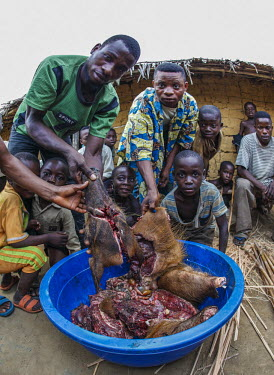 Bush meat in bowl in village Area of Lake Tumba,poaching,bush meat,hunting,illegal,local community,culture,traditions,project,WWF Congo,environmental issues,The Green Heart of Africa,people,village,meat,dead,Africa,Area del Lago