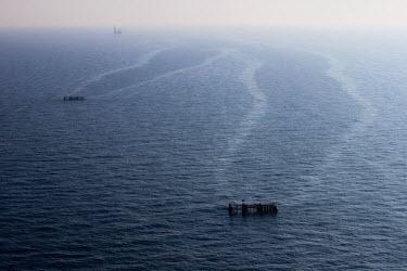 Platforms in sea oil rig,platform,oil,drilling,sea,surface,aerial,misty,atmospheric,environmental