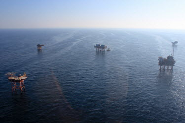 Oil rigs oil rig,platform,oil,drilling,sea,surface,aerial,misty,atmospheric,environmental