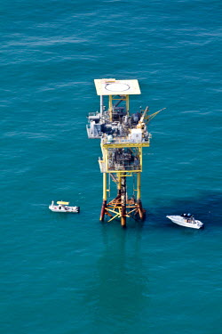 Island of steel serving as a habitat for a very large variety of reef and pelagic fish fishing,gulf,nature,conservation,issue,marine life,protection,offshore,oil rig,platform,oil,structure,artificial reef