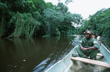 WWF International staff on patrol for poaching activities in North East Gabon Africa,conservation,conservation issue,conservation issues,patrol,patrols,boat,river,forest,ranger,rangers,WWF,staff,people,poaching,poachers,movement,wildlife trade