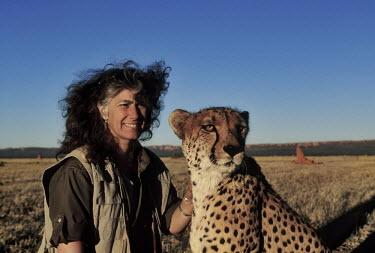 Laurie Marker, Director of The Cheetah Conservation Fund with a cheetah Africa,conservation,conservation action,research,big cat,big cats,mammals,people,rescue,Cheetah Conservation Fund,domesticated,habitat,plains,close up,close-up,Chordates,Chordata,Carnivores,Carnivora,
