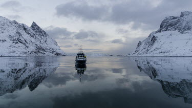 Light & Water Lofoten,Nordland,Norway,winter,fishing,vessel,boat,ship,calm,water,reflection,reflections,mountains,snow,sky,fishery,ripple,snowy,ice,fishing boat,human,Lofoten_Norway,Winter