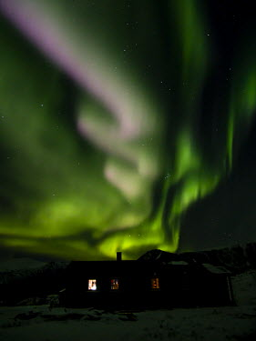Northern lights Tromso,Norway,northern lights,lights,sky,night,dark,stars,black,green,striking,diagonal,swirl,house,Troms,weather,night sky,natural spectacle,light,aurora borealis,TromsNorway