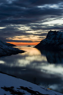 Dramatic landscape Troms,Tromso,Norway,sunset,low light,water,sky,snow,clouds,reflection,dark,moody,mountains,TromsNorway