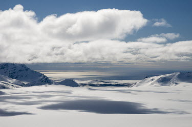 Light & Land Svalbard,Arctic,landscape,snow,light,white,snowscape,mountains,valley,clouds,blue sky,shadow,sea