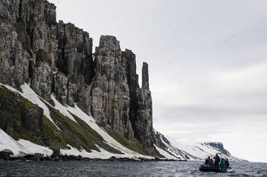 Man & Nature Svalbard,sea,cliffs,boat,people,camera,photographer,snow,dinghy,birds