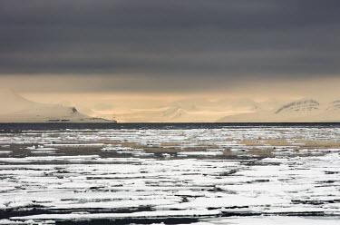 Atmospheric sea ice Svalbard,Arctic,winter,sea ice,sea,ice,water,atmospheric,seascape,mountains,clouds,low light,black water,white,grey