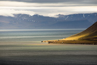 Svalbard Svalbard,cabins,landscape,seascape,mountains,sunlight,sunlit,exposed,elements,man & nature,water
