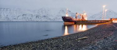 Arctic ship Svalbard,Arctic,ship,boat,dock,docked,lights,lighting,mountains,landscape,water,beach,low light