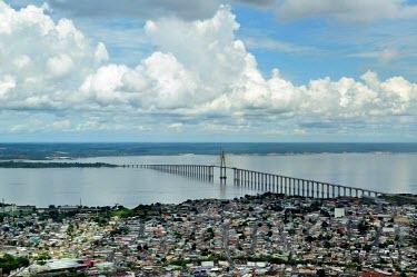 Aerial view of the Amazon rainforest and river, near Manaus city,bridge,Brazil,latin america,horizontal,river,amazon,spanish,forests,climate change,global warming,rainforests,urban,capital,Manaus,Amazonas,urbanisation,brazil