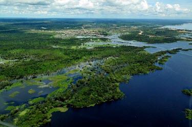 Aerial view of the Amazon rainforest and river, near Manaus brazil,latin america,horizontal,forest,river,amazon,aerial,spanish,forests,climate change,global warming,rainforests,rainforest,habitat,water,wetlands,urbanisation,destruction,deforestation,infrastruc