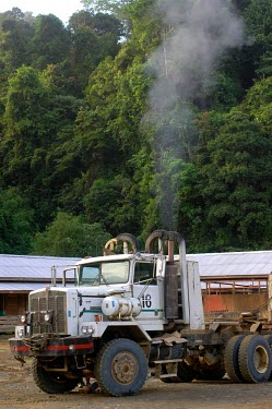 A truck ready to be loaded with logs in Gunung Lumut mountains,tree,truck,indonesia,rainforest,forests,timur,mla,verticals,kalimantan,gunung lumut,vehicle,logging,exhaust,fumes,pollution,gunung lumut mla cifor kalimantan timur indonesia truck forest rai