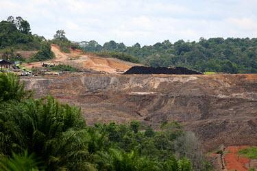 Coal mining in East Kalimantan, Indonesia horizontal,river,mine,mining,coal,climate change,natural gas,east kalimantan,oil palms,habitat,destruction,soil,earth,degraded,red,hill,mound