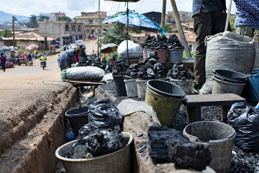 Charcoal seller at Mokolo Market africa,market,markets,charcoal,coal,seller,cameroon,yaounde,livelihoods,biofuel,charcoal seller,Mokolo,trade,deforestation,cooking,energy,Yaounde�,Cameroon,buckets,shallow focus,people,low angle,stree