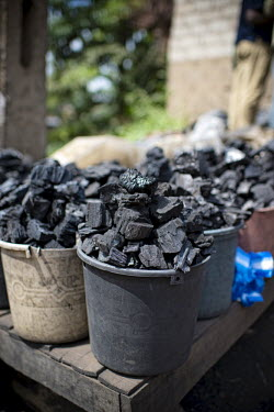 Charcoal seller at Mokolo Market africa,market,markets,charcoal,coal,seller,cameroon,yaounde,livelihoods,biofuel,charcoal seller,Mokolo,trade,deforestation,cooking,energy,Yaounde�,Cameroon,buckets,shallow focus