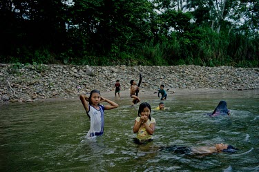 Kichwa children bathing on the banks of Misahualli River near Tena morning,people,girl,horizontal,children,ecuador,napo,deforestation,horizontals,kichwa,misahualli river,tena village,humans,human,river,pollution,polluted river,mining,tribe,tribal,forest,water,freshwa