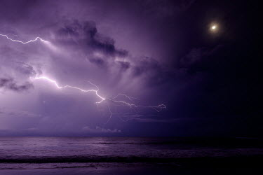 Lightning over the sea during a tropical storm storm,tropical storm,storms,lightning,night,night sky,beach,coast,coastal,coast line,atmosphere,weather,atmospheric,environment,climate,Americas,Central America,Costa Rica,tropical,tropics,horizon,Spa