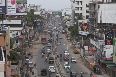 Too much motorized traffic in India causes chaos on the inadequate road system city,urban,dirty,traffic,human,humans,people,person,roads,road,car,vehicles,climate change,built environment,City Life,On the move,Direction,Chaos