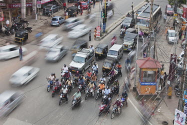Too much motorized traffic in India causes chaos on the inadequate road system city,urban,dirty,traffic,human,humans,people,person,roads,road,car,vehicles,climate change,built environment,scooters,scooter,electricity wire,electricity,City Life,On the move,Direction,Chaos
