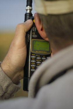 A researcher using radio telemetry equipment to track African wild dogs gray heron,grey,grey heron,heron,herons,storks,ponds and lakes,shallow focus,Streams and rivers,Europe,UK species,waterbird,waterbirds,wetlands,wingspan,flying,flight,bird,birds,birdlife,avian,wings,G