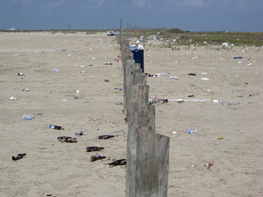 A beach littered with waste coast,coastal,coastline,beach,litter,trash,pollution,human impact,plastic pollution,waste,tide,tidal,plastic,landscape