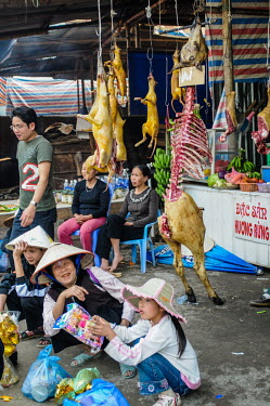 Bushmeat and dog hanging for sale in a Vietnamese market Stage,Dead