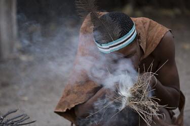 Botswana Bushmen creating fire - Botswana, Africa people,human,bushmen,bushman,indigenous