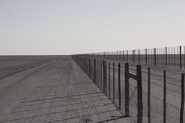 Perimeter fence - Botswana, Africa environment,ecosystem,Habitat,Terrestrial,ground,Xeric,Desert,dry,Arid,fence,perimeter,range,border,wall,blockade