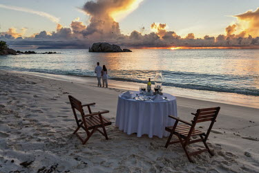 Dinner table on the beach for tourists - Seychelles sunset,tourism,tourists,human,travel