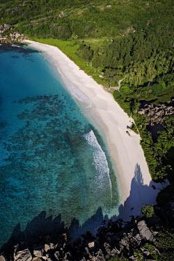 Aerial view of La Digue island - Seychelles saltwater,Marine,saline,Aquatic,water,water body,tropics,Tropical,Sea,seas,shoreline,Shore,sea shore,shoreland,sea side,Sky,beaches,Beach,environment,ecosystem,Habitat,blue skies,sunny,Blue sky,bright