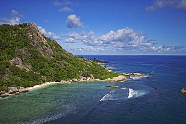 Aerial view of La Digue island - Seychelles environment,ecosystem,Habitat,coast,Coastal,coast line,coastline,saltwater,Marine,saline,Sea,seas,Aquatic,water,water body,reef,Coral reef,tropics,tropic,reefs,corals,tropical,coral structure,coral,co