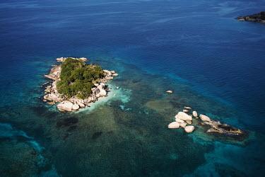 Aerial view of Coco Island - Seychelles. beaches,Beach,reef,Coral reef,tropics,tropic,reefs,corals,tropical,coral structure,coral,coral reefs,shoreline,Shore,sea shore,shoreland,sea side,Tropical,saltwater,Marine,saline,environment,ecosystem
