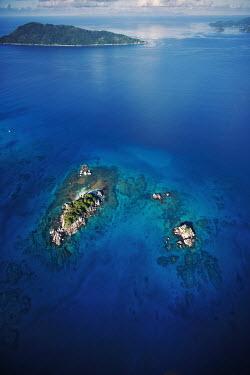 Aerial view of Coco Island - Seychelles. beaches,Beach,tropics,Tropical,Rocky shore,reef,Coral reef,tropic,reefs,corals,tropical,coral structure,coral,coral reefs,coast,Coastal,coast line,coastline,environment,ecosystem,Habitat,Sea,seas,Aqua