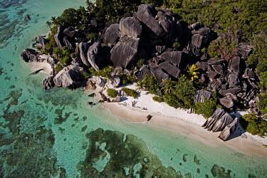 Aerial view of La Digue island - Seychelles beaches,Beach,environment,ecosystem,Habitat,shoreline,Shore,sea shore,shoreland,sea side,tropics,Tropical,saltwater,Marine,saline,Rocky shore,coast,Coastal,coast line,coastline,Aquatic,water,water bod