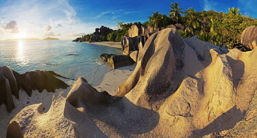 Source d'Argent - la Digue, Seychelles beaches,Beach,Evening,nightfall,sunsets,dusk,sun set,Sunset,shoreline,Shore,sea shore,shoreland,sea side,Sky,Sea,seas,coast,Coastal,coast line,coastline,reef,Coral reef,tropics,tropic,reefs,corals,tro