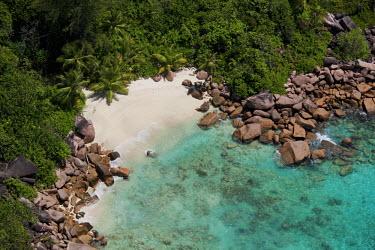 Aerial view of Praslin island - Seychelles tropics,Tropical,beaches,Beach,coast,Coastal,coast line,coastline,shoreline,Shore,sea shore,shoreland,sea side,reef,Coral reef,tropic,reefs,corals,tropical,coral structure,coral,coral reefs,environmen