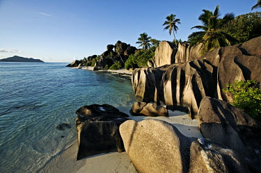 Granite boulders on the coast of La Digue - Seychelles shoreline,Shore,sea shore,shoreland,sea side,tropics,Tropical,blue skies,sunny,Blue sky,bright,environment,ecosystem,Habitat,saltwater,Marine,saline,Sky,Sea,seas,coast,Coastal,coast line,coastline,Aqu