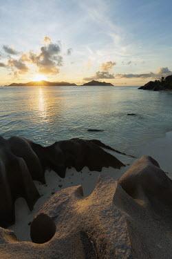Sunset over Anse Source d'Argent in La Digue - Seychelles Aquatic,water,water body,blue skies,sunny,Blue sky,bright,environment,ecosystem,Habitat,coast,Coastal,coast line,coastline,Sea,seas,saltwater,Marine,saline,shoreline,Shore,sea shore,shoreland,sea side