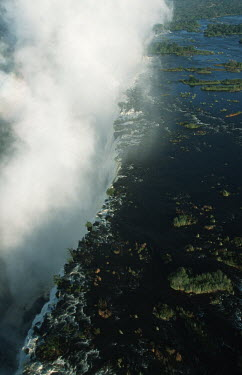 Aerial view of Victoria Falls - Zimbabwe Aerial,Waterfall,Spectacular,Light,Mist,Spray,Landscape,Formation,Geological,Water,River,Cliff