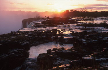 Victoria Falls at sunset, from Zambian side - Zambia Waterfall,Spectacular,Sunset,Sunbeam,Light,Mist,Spray,Landscape,Formation,Geological,Water,River,Cliff